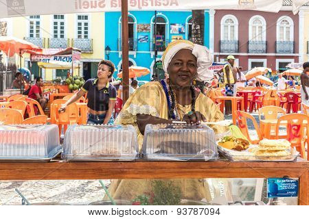 SALVADOR, BRAZIL - CIRCA NOV 2014: Baiana serving Acaraje in Bahia, Brazil. Acaraje is a typical food in the northeast of Brazil.