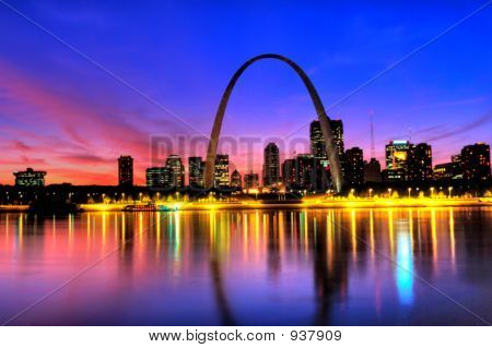 Saint Louis Skyline with the Mississippi river in front at sunset