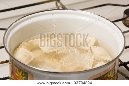 The Dumplings Cooks In A Pan With The Boiling Water