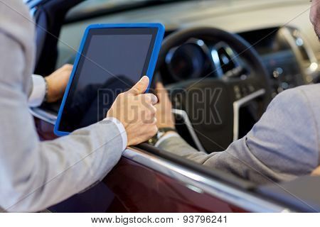 auto business, car sale, consumerism and people concept - close up of men with tablet pc computer in auto show or salon