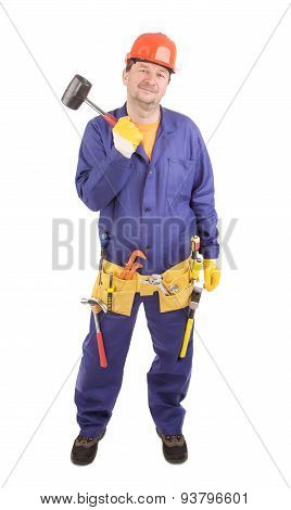 Worker in hard hat holds hammer.
