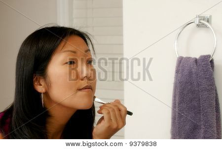 Woman Applying Makeup