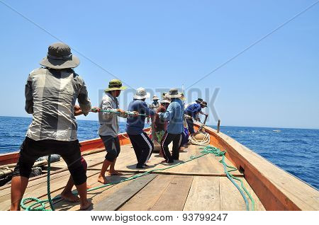 NHA TRANG VIETNAM - MAY 5 2012: Fishermen are catching tuna with a trawl net.