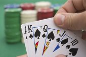 stock photo of ace spades  - poker player holding 10 to King spade straight flush of pokers A spade is coming - JPG