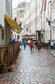 picture of cobblestone  - Tourists on cobblestone street of classic european old town blurred background - JPG