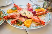 Постер, плакат: Dish with shrimp on the table in the restaurant