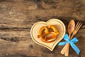image of pretzels  - Oktoberfest festival background with pretzel on cutting board - JPG
