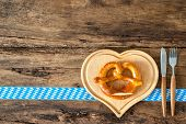 stock photo of pretzels  - Oktoberfest festival background with pretzel on cutting board and cutlery set - JPG