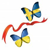 stock photo of sweden flag  - Two butterflies fluttering with flags of Ukraine and the Sweden - JPG