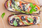 picture of aubergines  - aubergine stuffed with vegetables and cheese on wooden board - JPG