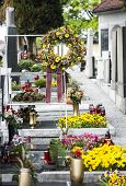 image of funeral  - Funeral bouquet placed over the new grave - JPG