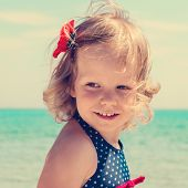 picture of bobbies  - Funny little girl on the beach. The image is tinted. ** Note: Soft Focus at 100%, best at smaller sizes - JPG