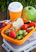 pic of lunch box  - Lunch box for kids with sandwich cookies fresh veggies and fruits  - JPG