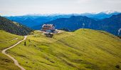stock photo of bavarian alps  - The cabin Rotwandhaus in the Bavarian Alps near Lake Schliersee