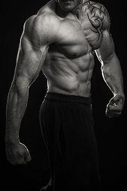 picture of bodybuilder  - Muscular man bodybuilder with tattoos - JPG