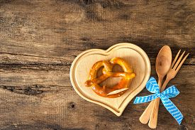 stock photo of pretzels  - Oktoberfest festival background with pretzel on cutting board - JPG