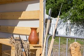 picture of trident  - gladiatorial net and trident on a wooden bench - JPG