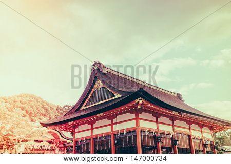 Fushimiinari Taisha ShrineTemple in Kyoto, Japan  ( Filtered image processed vintage effect. )