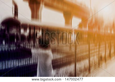 The boys were waiting at the train station with a blurred image.