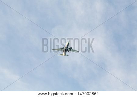 Two Engine Jet from Below in Blue Sky