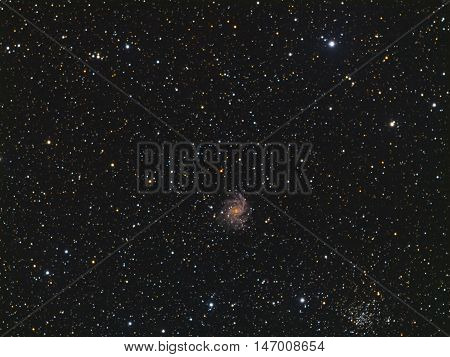 Fireworks Galaxy NGC 6946 and NGC 6939 Cluster near Milky Way