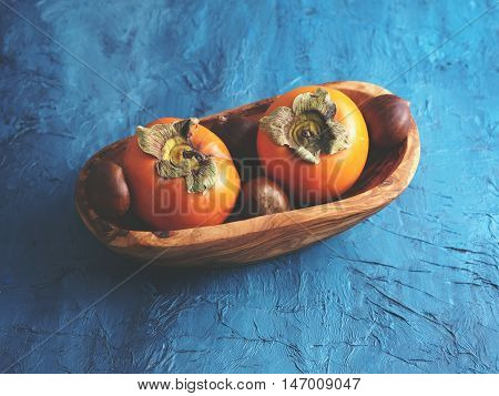 Persimmons And Chestnuts In A Bowl