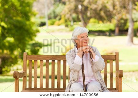 Woman With Her Walking Stick In The Park