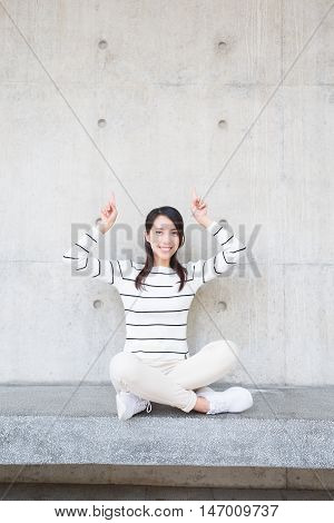 beauty woman smile and shoe something to you with white wall asian