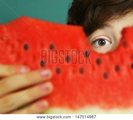 preteen boy eat water melon close up portrait