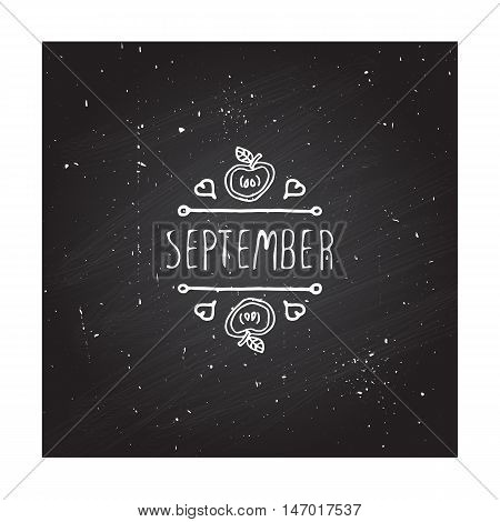 Hand-sketched typographic element with apple, hearts and text on blackboard background. First month of fall - September.