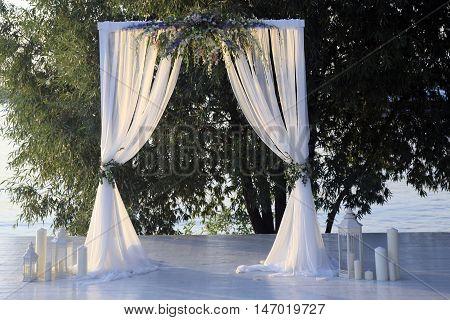 Beautiful wedding arch on the coast river
