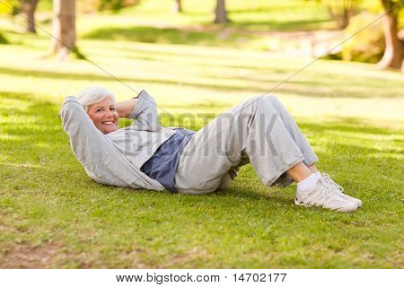 Retired Woman Doing Her Stretches In The Park