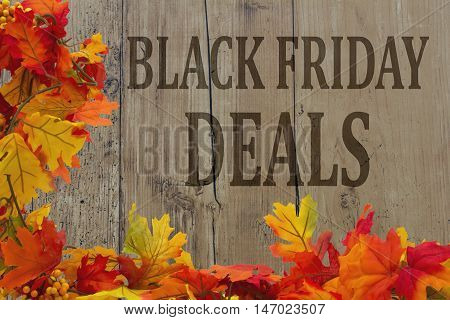 Black Friday Shopping Deals Autumn Leaves with grunge wood with text Black Friday Deals