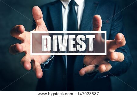 Divest concept with businessman in suit - finance and economics business theme.