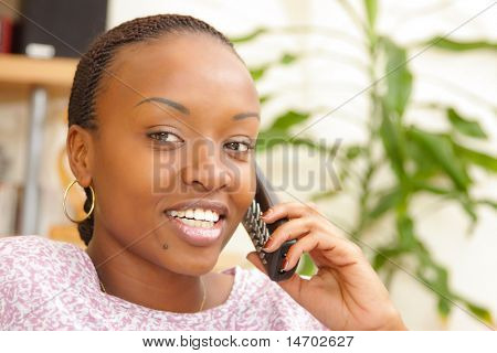 Picture of a happy woman on the phone at home