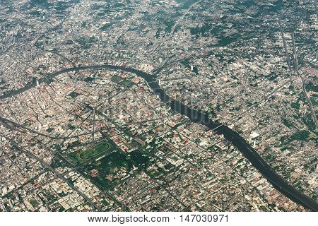 Aerial view of Bangkok metropolis and Chaophraya river. Thailand.
