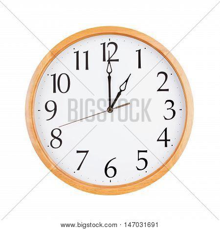 Exactly one o'clock on the large round clock
