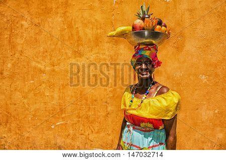 Cartagena de Indias Colombia - February 23 2014: Colombian woman wearing traditional clothes in Cartegena de Indias in Colombia.