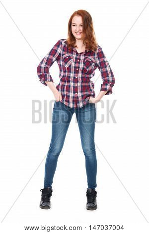 Young pretty curly woman in plaid shirt and jeans posing and smiling. Beautiful girl in full-length isolated on white background
