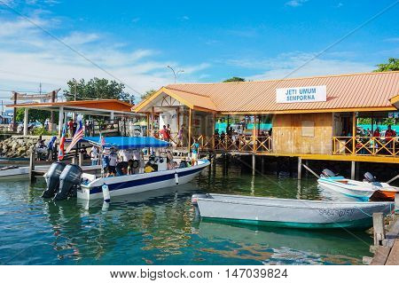 Semporna,Sabah-Sept 10,2016:Jetty of speedboats terminal in Semporna,Sabah,Borneo on 10th Sept 2016.Its a gateway for diving & snorkeling trips to the islands of Sipadan,Mabul,Mataking,Maiga & others