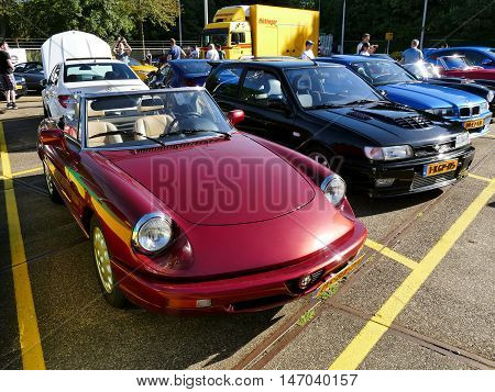 Amsterdam, The Netherlands - September 10, 2016: Red Alfa Romeo Spider 1992 On Display During Cars &