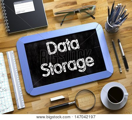 Data Storage - Text on Small Chalkboard.Data Storage. Business Concept Handwritten on Blue Small Chalkboard. Top View Composition with Chalkboard and Office Supplies on Office Desk. 3d Rendering.