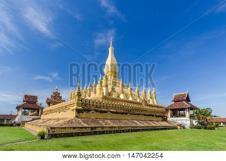 Golden pagada in Pha-That Luang tample on blue sky background Vientiane Laos.