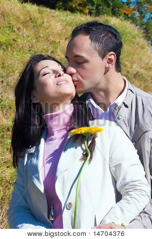 Young man kissing his girlfriend