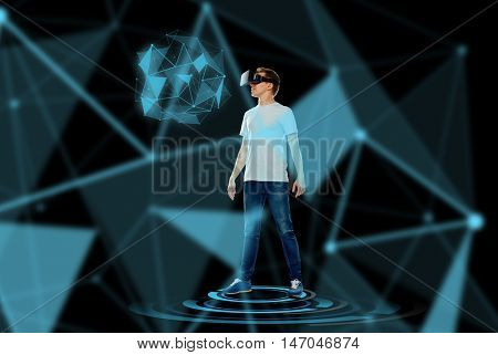 3d technology, gaming, augmented reality, cyberspace and people concept - happy young man with virtual reality headset or 3d glasses looking at low poly shape hologram