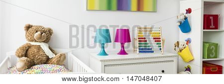 Ideas for colorful baby bedroom with white furniture