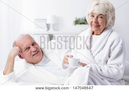 Elder Couple In Bathrobes