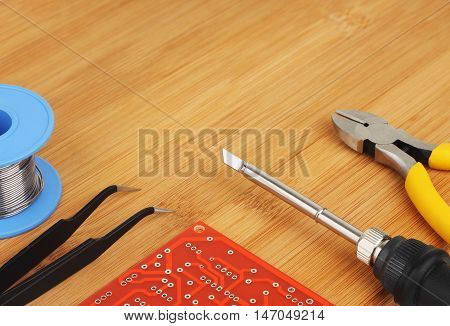 Printed circuit board and hand tools for electronics assembly. Shallow DOF.