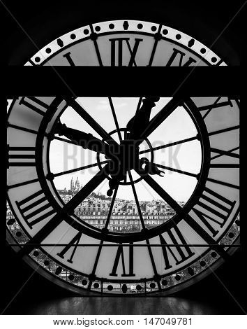Paris France - August 26 2015: View through d'orsay museum clock tower of Sacre-Coeur Basilica in black and white. Montmartre hill Paris France