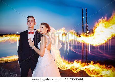 Newlyweds Hugging Near Lake By Night